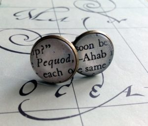 Book-themed cufflinks.