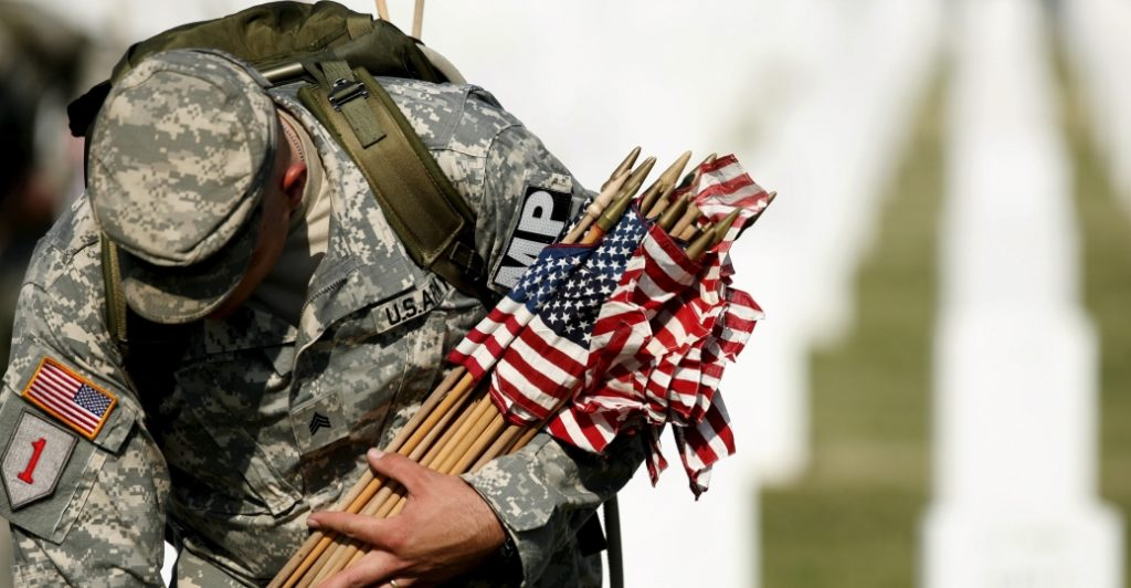 An American soldier honors the fallen on Memorial Day.