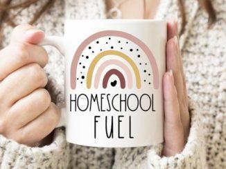 Mom holding Homeschool Fuel coffee mug