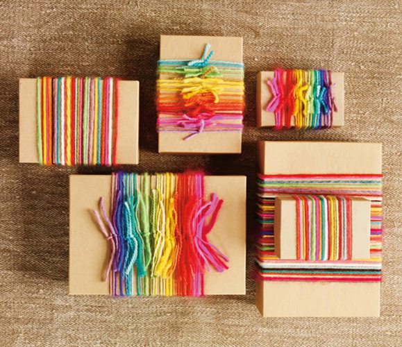 gifts wrapped in rainbow yarn