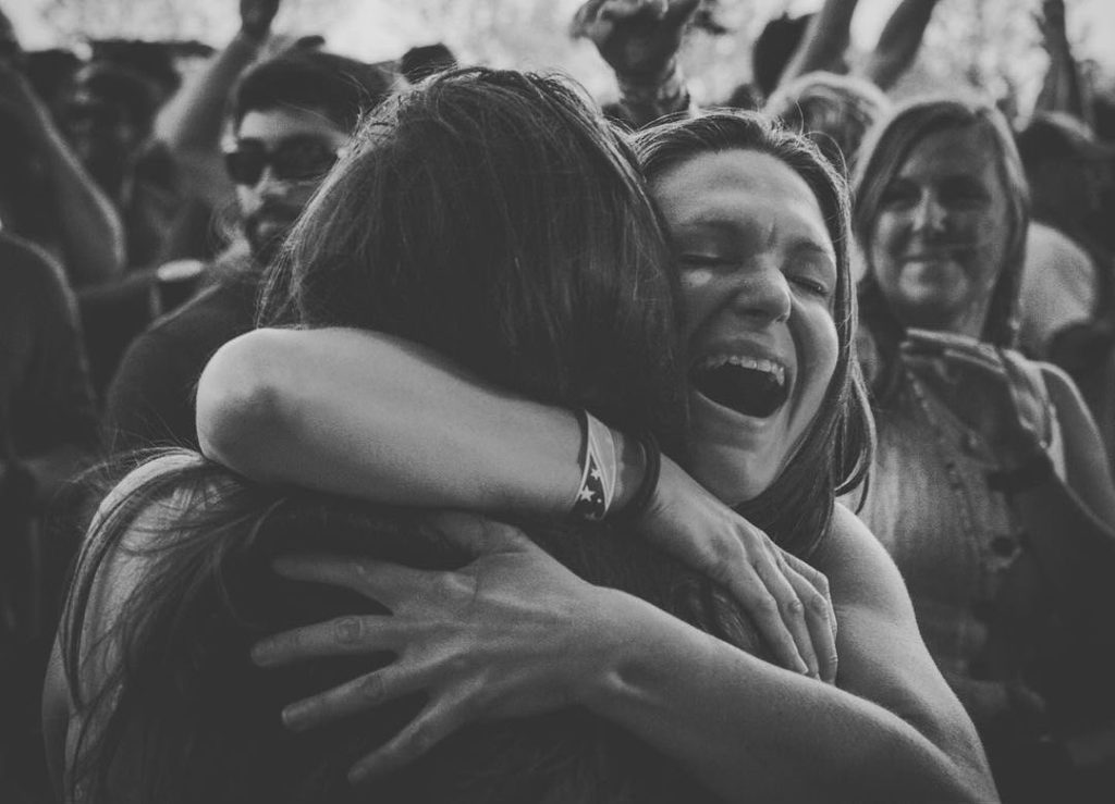 Widespread Panic fans greet each other with a hug